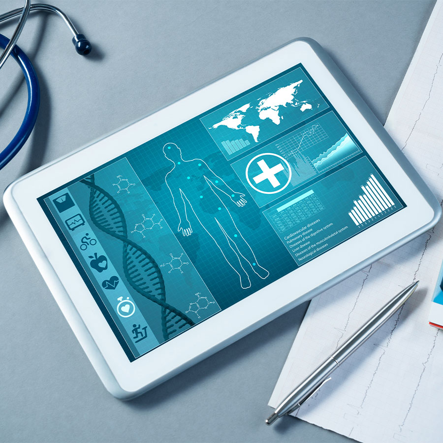 Tablet with medical information and medical tools on a table